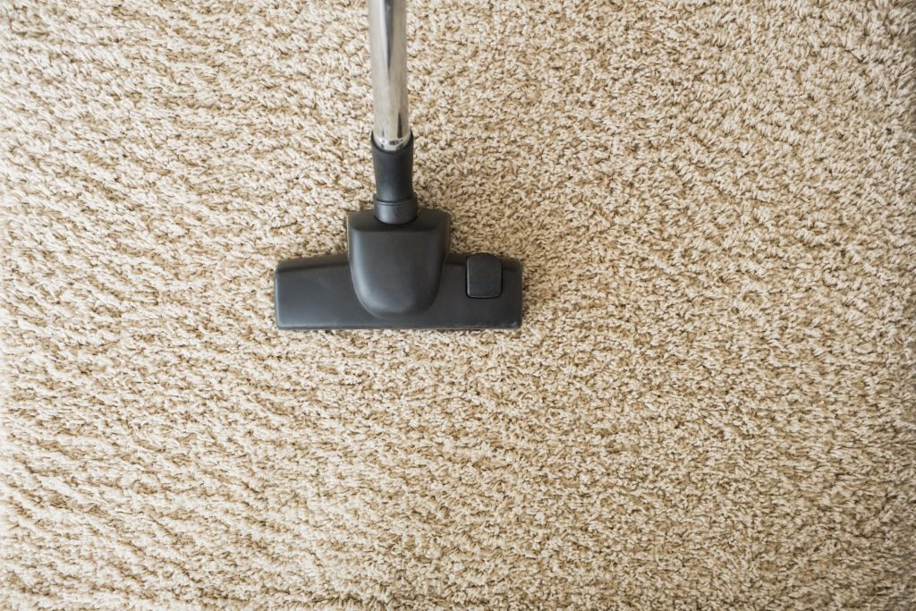 Vacuum cleaning a living room carpet