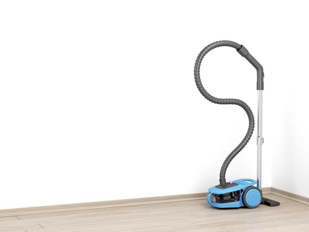 Vacuum cleaner cleaning the hardwood floor